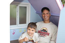 Samir Shahin and son Sam take a break while building the coop. The handprints of Emily and Sam on the back wall were added to celebrate their involvement in building the coop. Every element in the coop, including the inside, was painted prior to assembly.