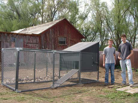 Colorado Chicken Coops' co-founders Jeff Troutman (left) and Eric Millinger (right) with one of their coops on a farm near Boulder, Colorado.